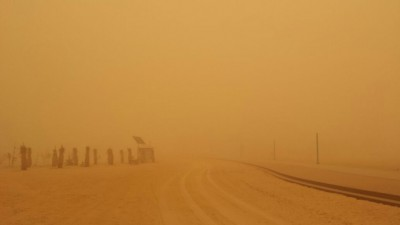 Sand storm covered the roads with dust