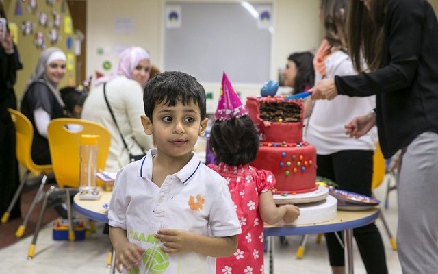 A pupil at the New England Centre for Children celebrates his sixth birthday. The centre in Mohammed bin Zayed City, Abu Dhabi, says demand is so high that it will add two classrooms next year, with room for 14 more autistic children