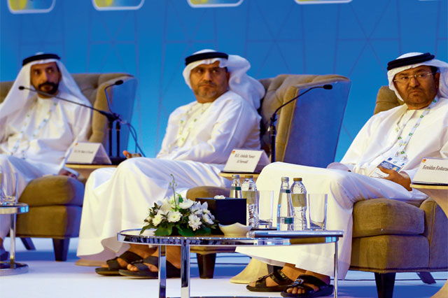 Mubarak Al Ketbi, deputy director, marketing and refining Abu Dhabi National Oil Company (Adnoc), Dr Matar Hamed Al Neyadi, Undersecretary at the Ministry of Energy, and Abdulla Nasser Al Suwaidi, director-general, Adnoc, during the oil company's annual 23rd Middle East Petroleum and Gas Conference in Abu Dhabi.