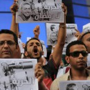 "Journalists take part in a protest against the detention of Ahmed Ramadan, a photojournalist with the private Egyptian newspaper ""Tahrir,"" in front of the Syndicate of Journalists in Cairo, Egypt"