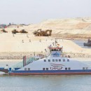 A ship named 'Long life Egypt' crosses the new section of the Suez Canal after the opening ceremony of the new Suez Canal, in Esmailiya, Egypt. Egypt's ambassador said that Egypt is working on a number of mega projects from which Indian investors can benefit.