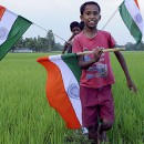 Children wave the Indian flag to celebrate the exchange of enclaves between India and Bangladesh. The exchange of 162 enclaves is taking place on July 31, 2015, marking the start of implementation of their landmark land boundary agreement.