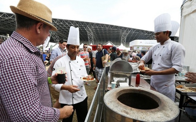 People trying food at different restaurant in the Taste of Abu Dhabi held at Du Arena at Yas Island in Abu Dhabi in 2014.