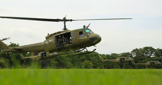 An American businessman sold UH-1 Huey helicopters, including the one pictured being flown by the Armed Forces of the Philippines last month, but found himself facing bribery accusation.