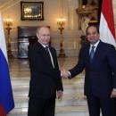 Russia's President Vladimir Putin (L) shakes hands with Egypt's President Abdel Fattah el-Sisi during a meeting in Cairo