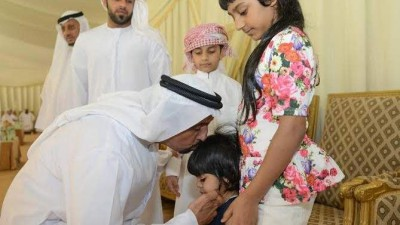 Dr Shaibani comforting the little kid of martyr Ali Hassan Al Shehi