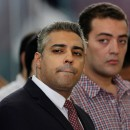Mohamed Fahmy, left, and Baher Mohamed, Al Jazeera journalists, at a court hearing in Cairo in June. The imprisoned journalists were pardoned on Wednesday by President Abdel Fattah el-Sisi. Credit Amr Nabil/Associated Press