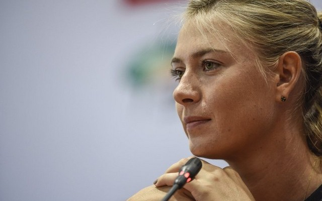 Maria Sharapova shown at a press conference on Saturday ahead of the WTA Wuhan Open. Fred Dufour / AFP / September 26, 2015