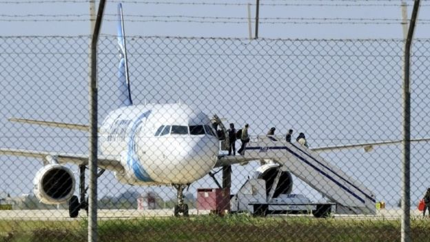 Negotiations began and then people were seen emerging from the plane