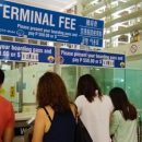 Filipinos Paying Terminal Fees at Ninoy International Airport