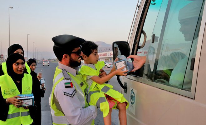 Ajman Police Distributing Iftar Meals