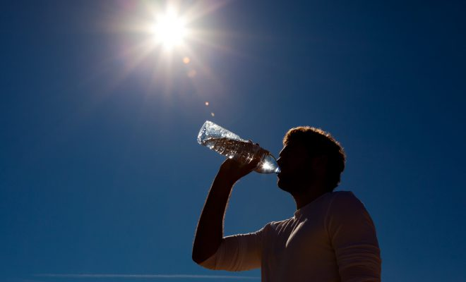 Man Drinking Water in Hot Weather